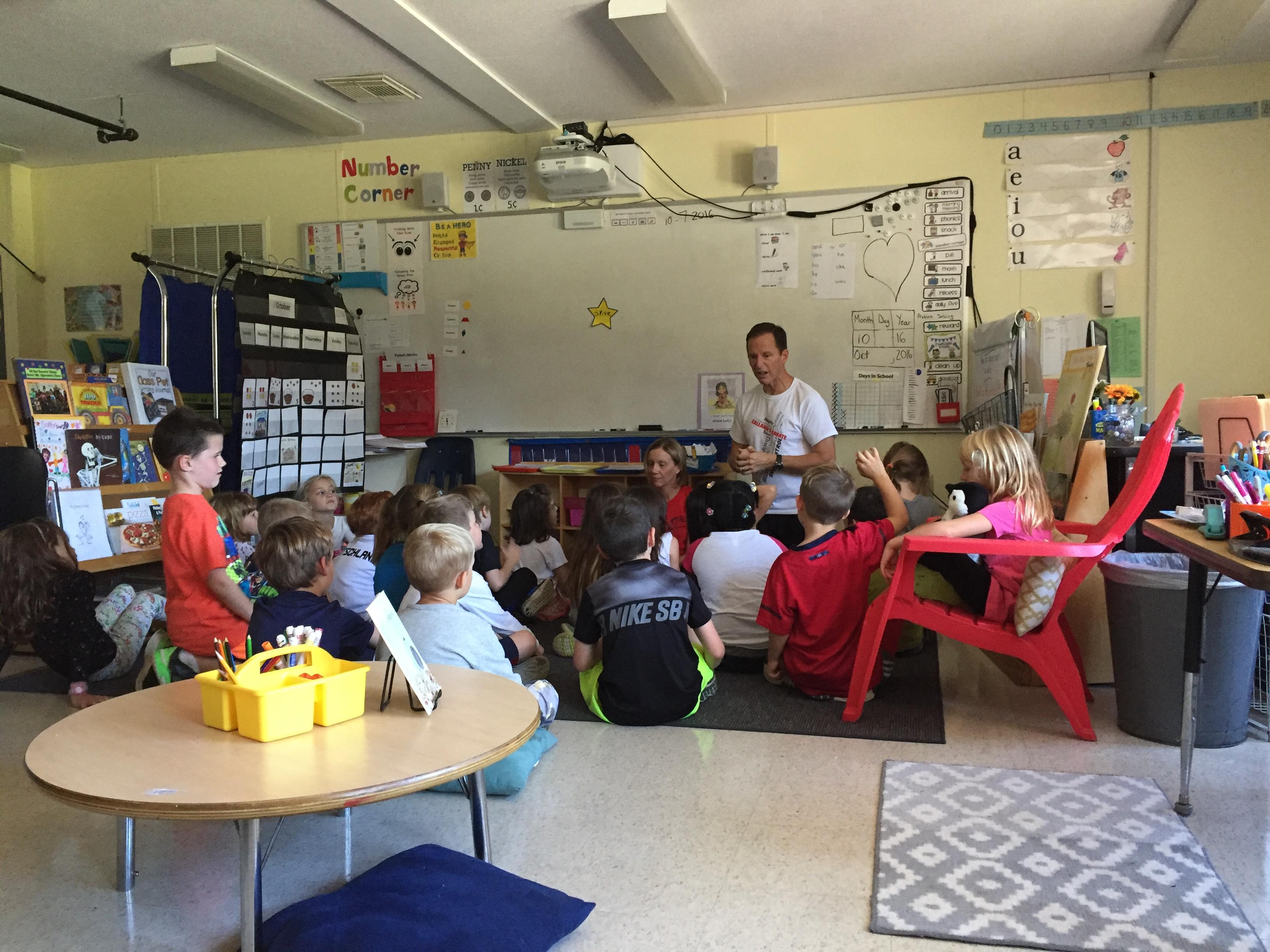 Classroom listening to Mr. Callahan speak on being good leaders.