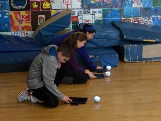 Lane School students programming Sphero robots to move through an obstacle course.