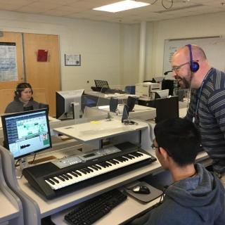 High School students creating music content in the Music Lab.