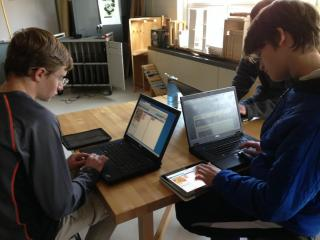 High School students coding during an Hour of Code activity.