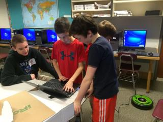 Lane School and High School students programming a Create robot from iRobot.