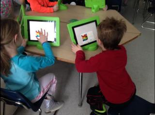 Davis students using iPads to complete classroom assignments.