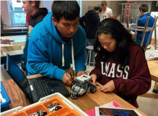 High School students designing and programming a robot.
