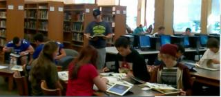 High School students working in the library.